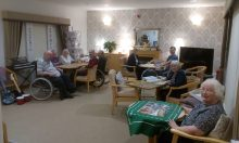 Oakburn Gardens tenants appear in a charity PR photo for Bield