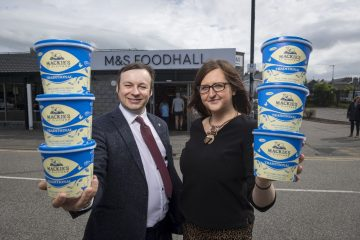 Food and Drink PR photograph of Bill Thain, National Account Manager at Mackie's and Leigh Brogan, M&S Inverurie Store Manager holding tubs of Mackie's of Scotland Traditional ice cream