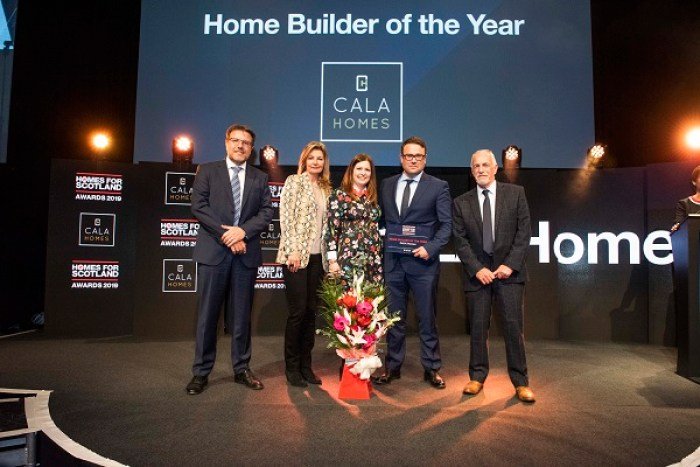 CALA staff appear on stage to collect an award for The Crescent. Property PR in action
