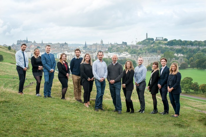 PR Photography of Clan Gordon's staff with  Edinburgh skyline in the background.