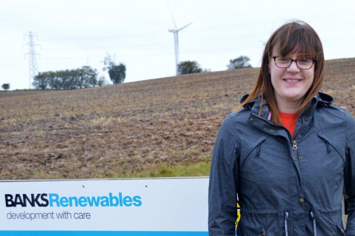 Scottish PR photography Rachel Allum, principal development planner, Banks Renewables - turbines behind