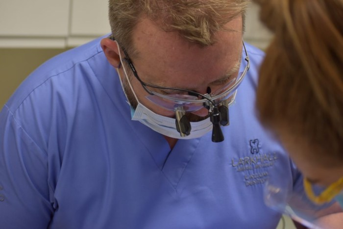 Health PR photography shot of Dr Callum Graham at work, Clyde Munro Dental