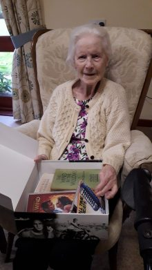 Social care PR photography Ellen and activity box, Mansfield Care