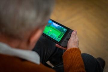 social care PR photography Professor Pompa playing on Nintendo Switch, Cramond Residence
