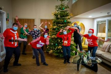 social care PR photography Christmas jumper day at Cramond Residence