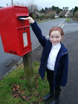 PR photography of Trooper Murrin posting her card to Belhaven House in a Care PR story by public relations experts Holyrood PR.