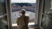 Pope Francis giving a blessing over an empty St. Peter's Square and Horizon