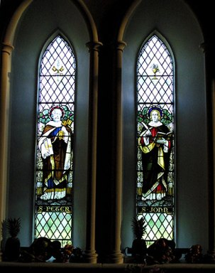 Two windows beside the organ console depicting St Peter with the Keys and St John writing the Gospel.