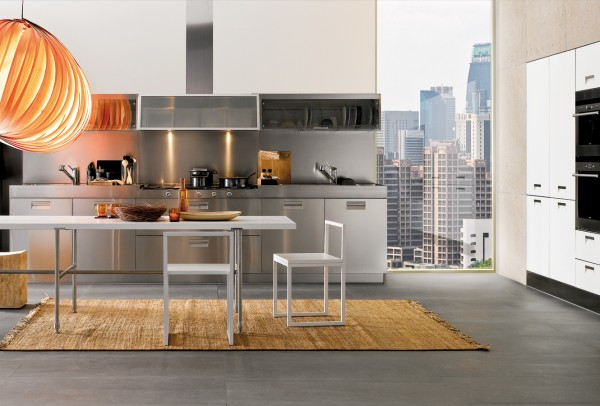 A built in wall of cabinets and appliances saves space in this apartment kitchen.