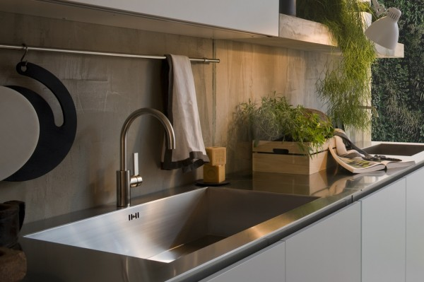 These stainless steel kitchen counters are stylish yet very easy to clean and maintain, making it a very desirable kitchen fixture.