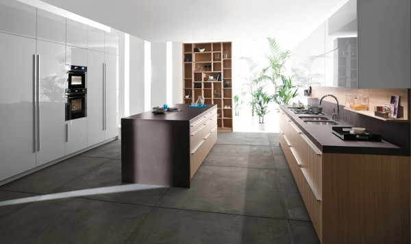 A kitchen that takes up this much space has to be organized. Hidden cabinets, tons of storage and cleverly disguised appliances are just the ticket.