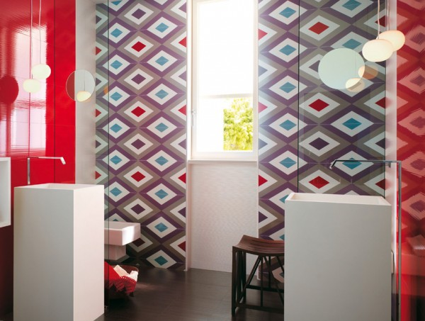 This bathroom makes a statement and then some! Geometric patterns adorn large wall tiles, creating a splash of statement color in a room that quite often lacks oomph! The facing cuboid basins add to the off-beat quirky image of the room.