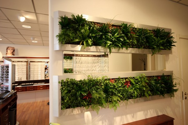 An even more vertical solution, this wall with built in planters is part room divider, part garden.