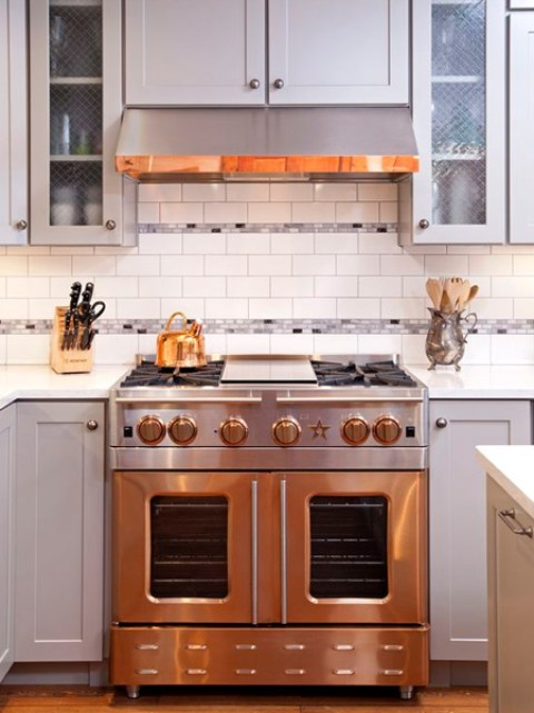 Wood mantle hoods are being replaced with metal hoods or a combination of wood and metal. So if you are looking to follow suit, a combination of neutral colour tones and metal hoods will bring a burst of contrast into your kitchen.