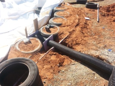 Earthtubes come out of the back of each dome