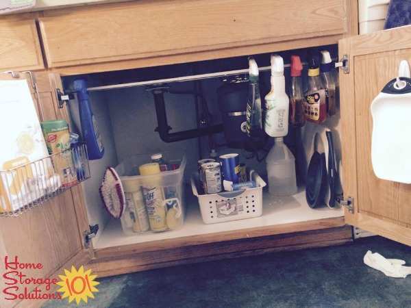 under kitchen sink organizer faucet aerator cabinet organization ideas you can use a tension rod your to hang spray bottles for easy