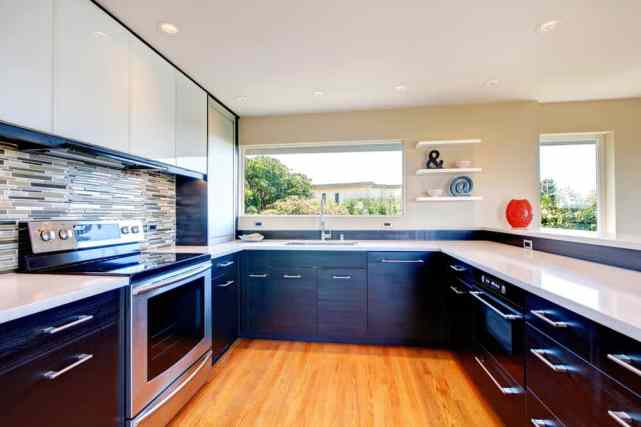 stunning kitchen with lower black cabinets and upper white cabinets