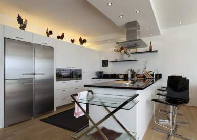 contemporary kitchen with stunning visual aesthetics and black bar stools