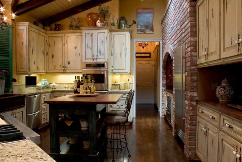 country kitchen with a stone enclosure