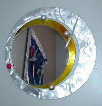 Mirror in brushed aluminum and contemporary style mirror. Mirror is abstarct mirror with a modern