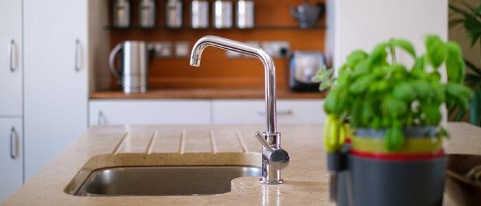 replace a faucet kitchen bathroom