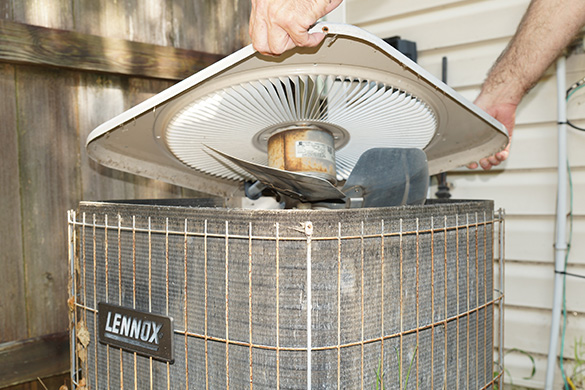 Removing and inspecting air conditioning condenser fan assembly