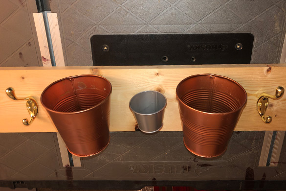 Storage tins and hooks for a DIY wall mounted coat rack