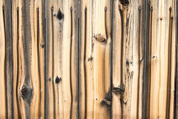 Screws bleeding on planks of wooden fence