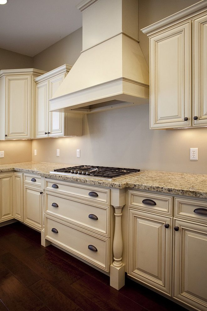 Candlelight Cabinets For A Beach Style Kitchen With Beige Floor