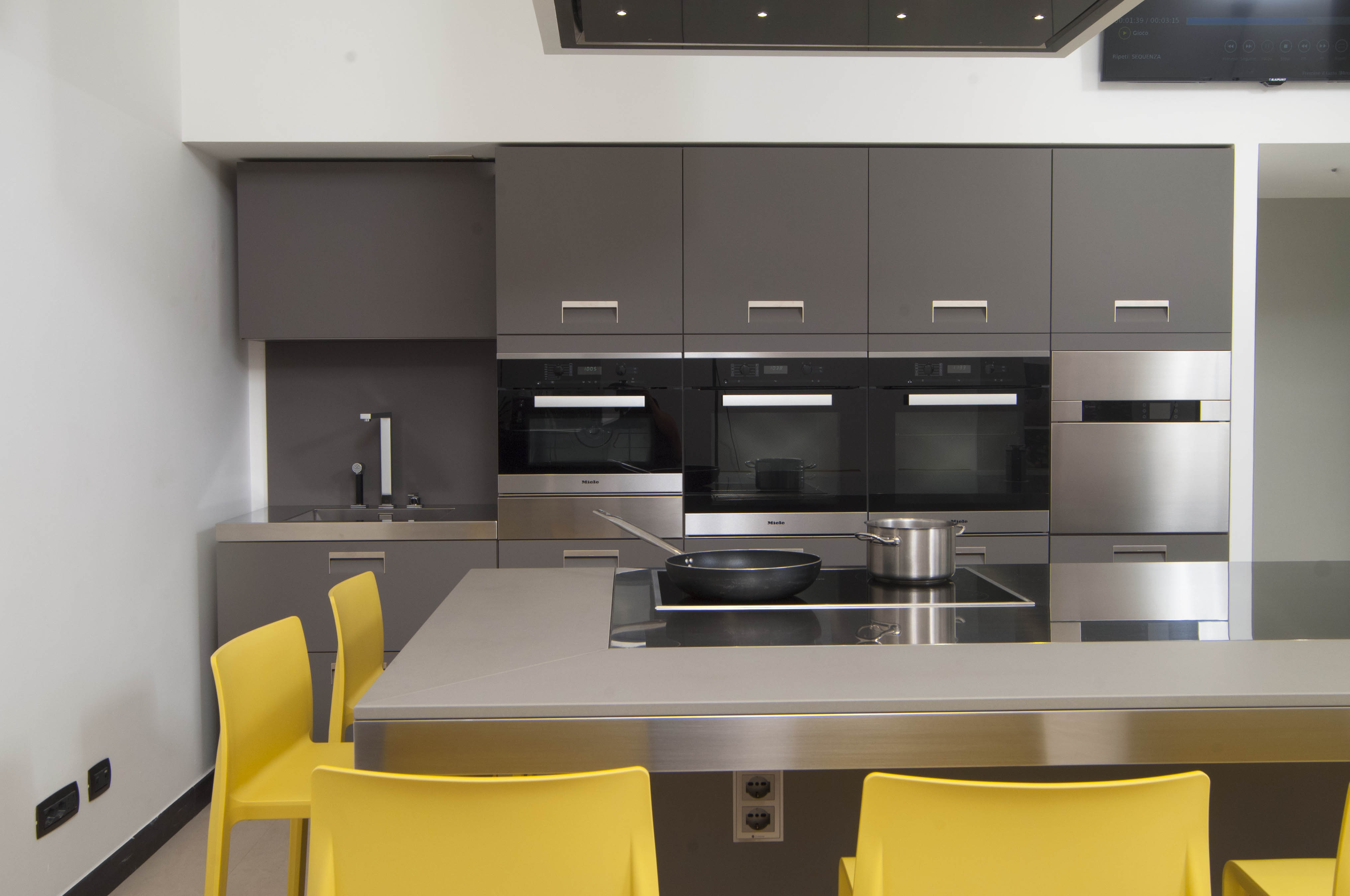 miele kitchen appliances back splash protagonist of the italian chef cooking school