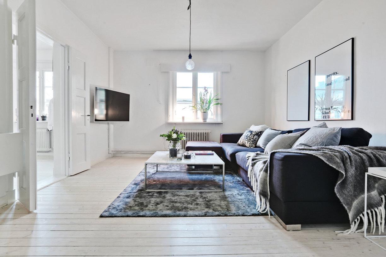 Woonkamer van een klein Scandinavisch appartement  HOMEASE