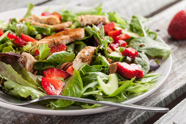 Strawberry Balsamic Salad - Baby salad greens, fresh strawberries, lemon chicken, roasted almonds and honey balsamic vinaigrette - delicious!