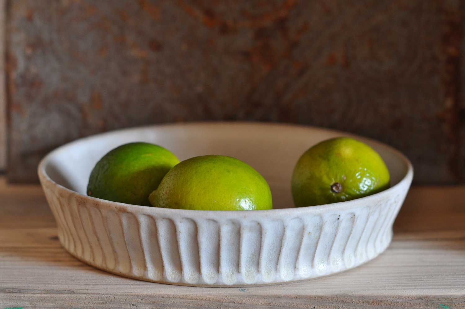 Hand thrown and carved flan dish by Hilda Carr