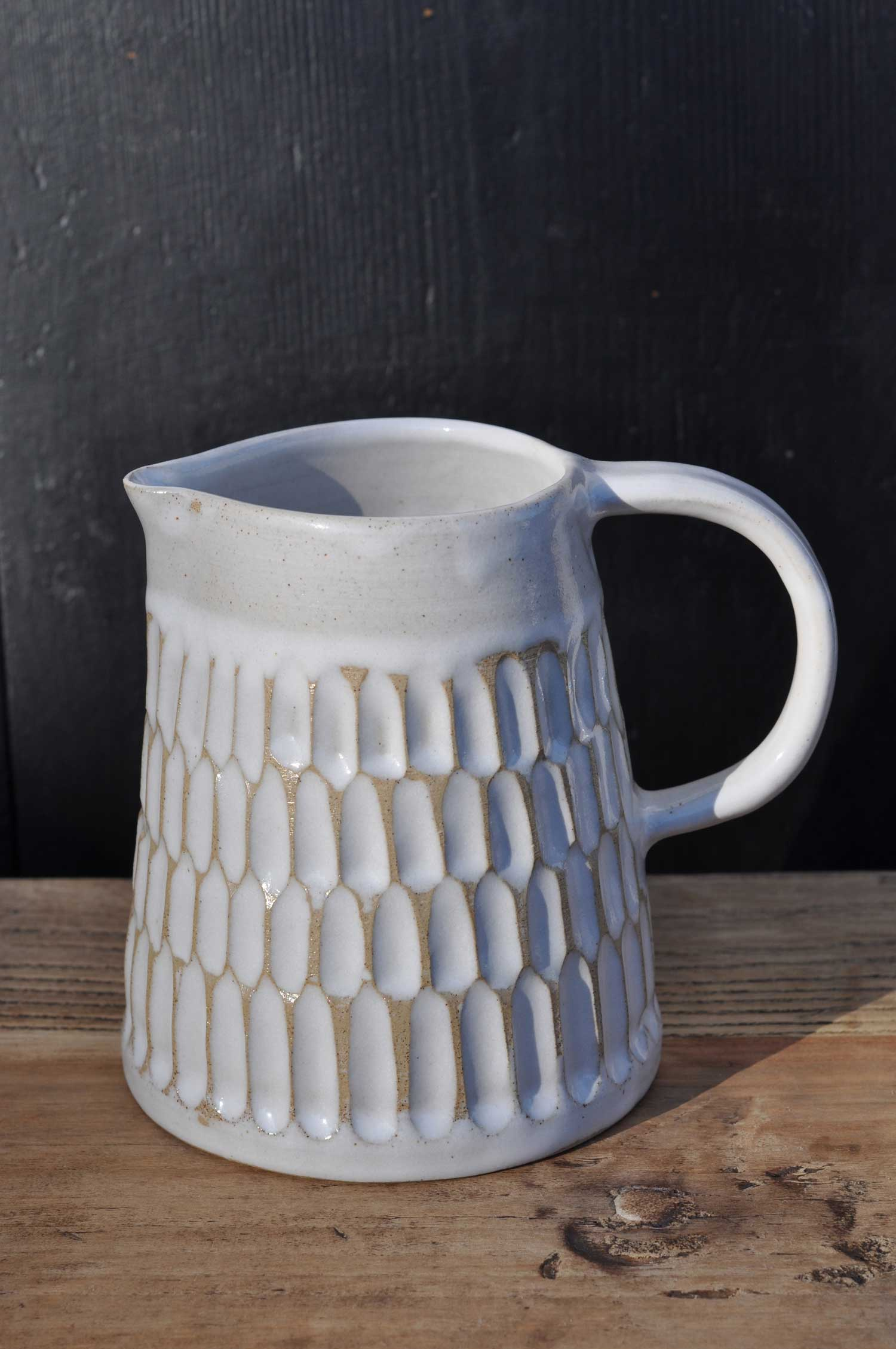 Hand thrown and carved gloss white jug by Hilda Carr