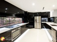 Modern Style Galley Kitchen with Stone bench tops