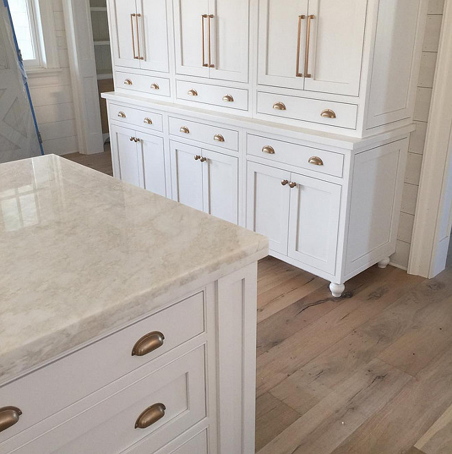 Kitchen. White inset cabinets with antique brass hardware and marble tops make for a great kitchen combination. Antique brass hardware is from Atlas Hardware. #kitchen #whitecabinets #insetcabinets #marblecountertop #antiquebrasshardware Artisan Signature Homes.