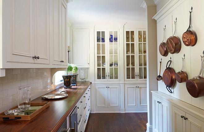 white kitchen with brick backsplash