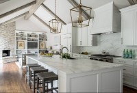 Remodeled White Kitchen with Vaulted Ceiling Beams