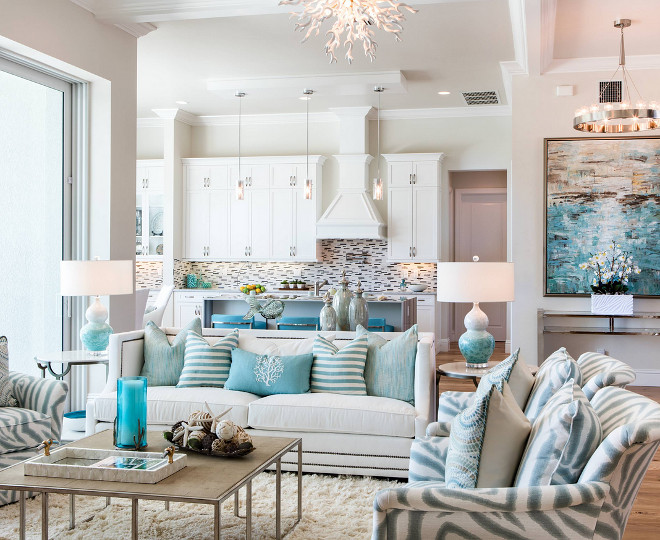 Living room color palette. The color palette of this living room includes blues, aquas and natural browns accented by metallic silvers and grays - soft, cool tones that subtly change from room to room just as the Gulf Coast waters change from morning to night. Living room color palette ideas. Living room color palette #Livingroom #colorpalette