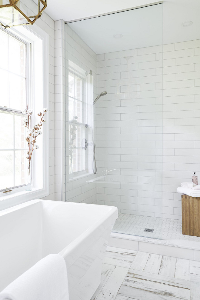 Large subway tile shower ideas. Bathroom with Large subway tile shower. Large subway tile shower. Shower features large subway tile on walls and hex tile on floor #Largesubwaytile #shower #showertile Square Footage Inc.