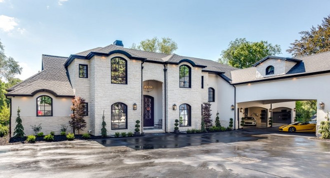 Modern French Chateau Style Custom Home Design. I could never get tired of the architectural details of this home. I love the stone exterior and the porte-cochère. Modern French Chateau Style Custom Home Design #ModernFrenchChateau #FrenchStyleHome #CustomHome #HomeDesign