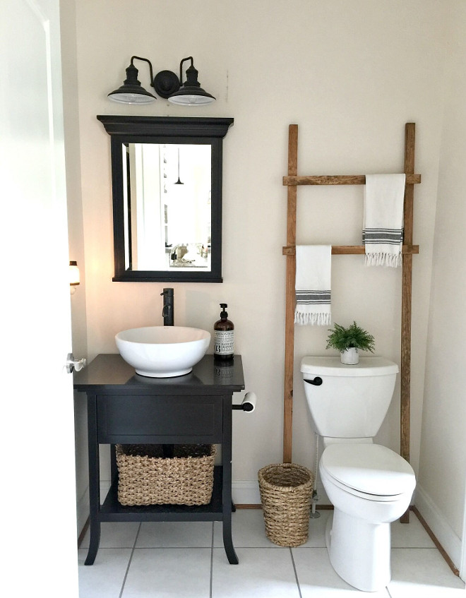 Small Farmhouse Bathroom. Small Farmhouse Bathroom with towel ladder. Small Farmhouse Bathroom #SmallFarmhouseBathroom Beautiful Homes of Instagram @middlesisterdesign - Home Bunch