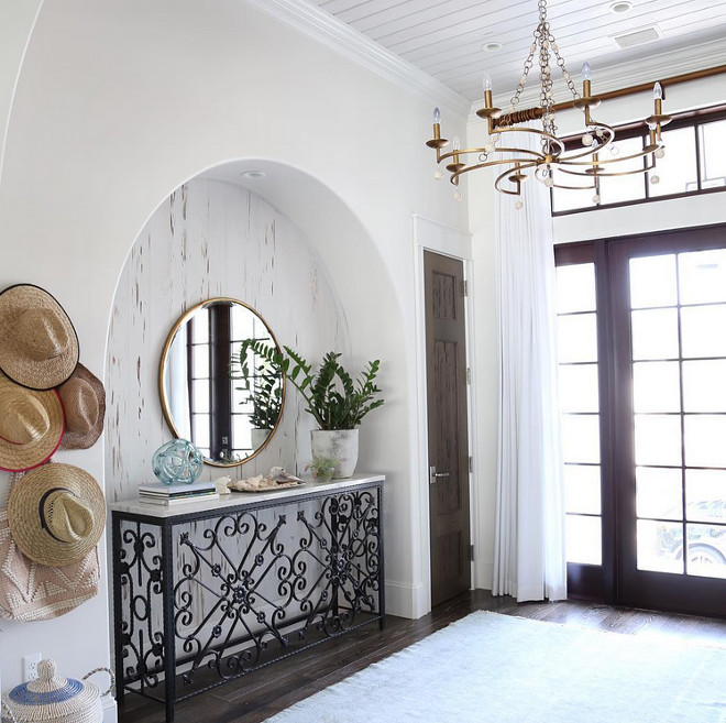 Arched Nook. Foyer with arched nook featuring pecky cypress wood. Arched Nook Foyer #ArchedNook #peckycypress #peckycypresswood