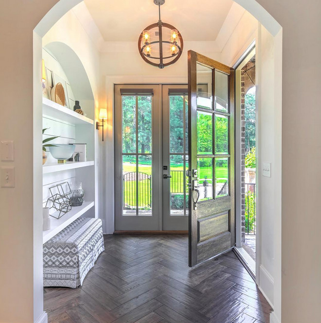 Foyer Design. Foyer with herringbone hardwood floors and arched nook with shiplap and shelves. Foyer. Foyer design #foyer #foyerdesign #herringbonehardwoodfloors #hardwoodfloors #archednook #nook #shiplapnook #shiplap Via Beacham & Company