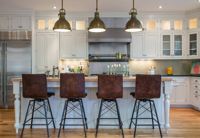 Kitchen Leather Counterstools. Classic white kitchen with leather counterstools. This white kitchen has a traditional look but it's layered with industrial and modern elements. #kitchen #counterstools Restyle Design, LLC.