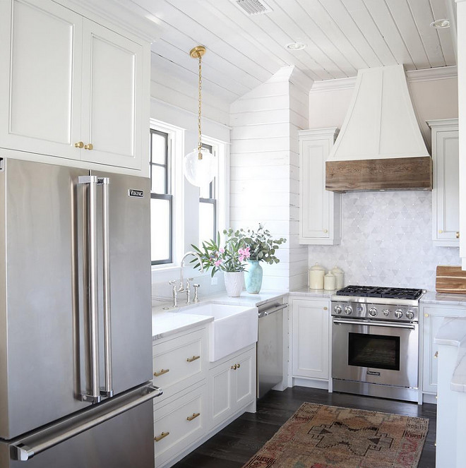 Small kitchen shiplap. Small kitchen with shiplap backsplash and shiplap ceiling. Lighting is Visual Comfort TOB5226HAB/G2-SG Thomas O'Brien Katie Acorn Pendant. Small kitchen with shaker cabinet doors, shiplap backsplash and shiplap ceiling. #smallkitchen #shiplap #kitchenshiplap #backsplashshiplap #shakercabinets #VisualComfort #TOB5226HAB/G2SG #ThomasOBrien #KatieAcornPendant oldseagrovehomes