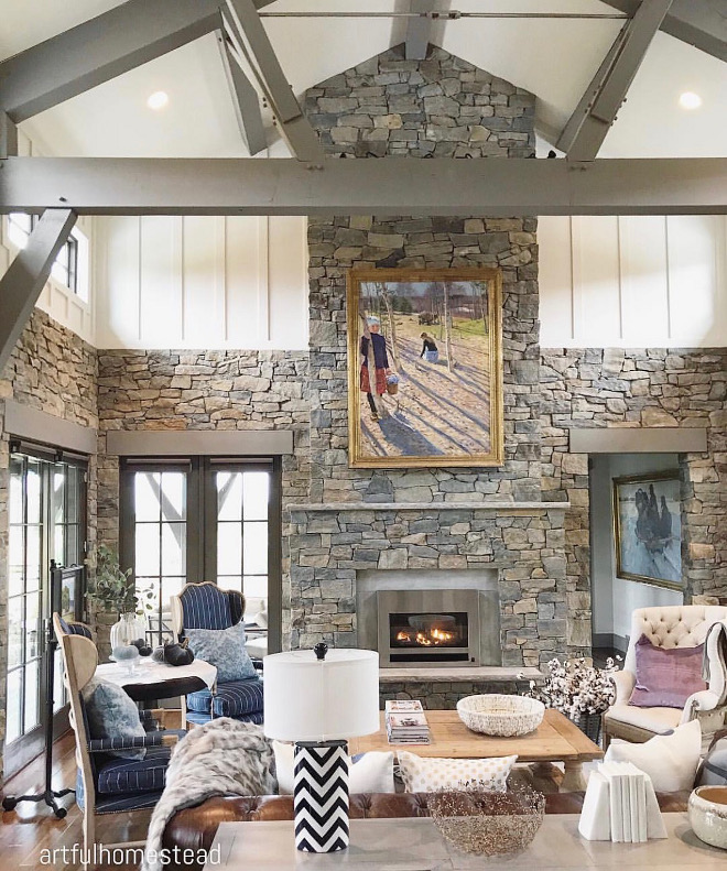 Stone and board and batten living room. Beams and trims are Sherwin Williams SW 0023 Pewter Tankard. Beams are painted in a grey color to unify with natural stone #stone #naturalstone #boardandbatten #beams @artfulhomestead