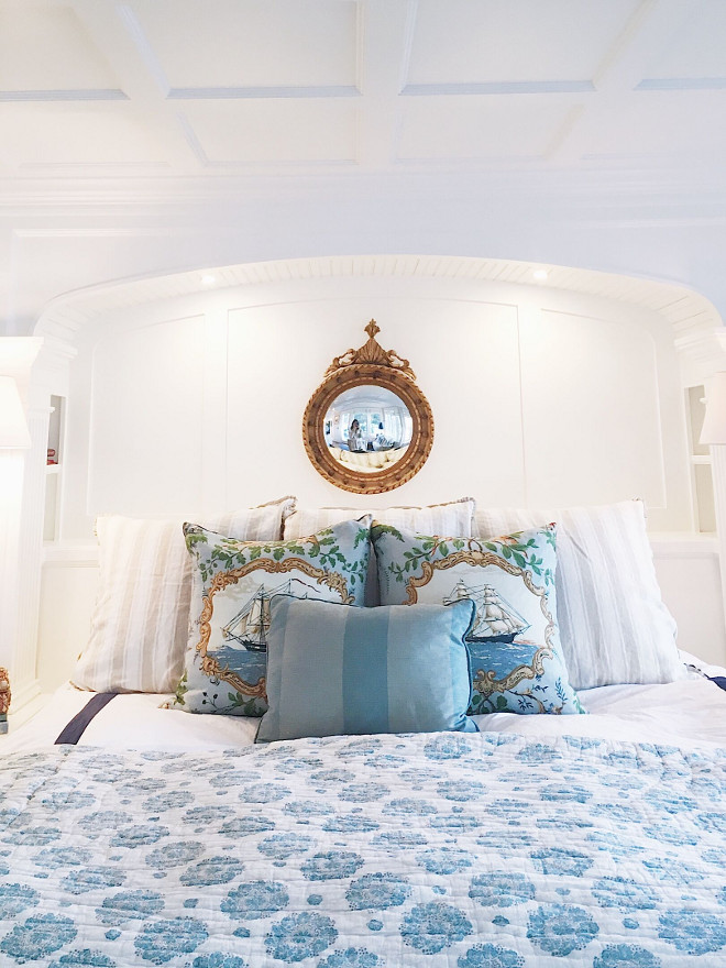 Blue and white bedding. Classic white bedroom with alcove and blue and white bedding. Bed is flanked by bookcases with an arched top and coffered ceiling. Linen bedding is Quatrine, clipper ship pillows are Schumacher, striped pillow is Quatrine. Blanket is from Nantucket. #bedroom #blueandwhitebedding #bedding #bedroomalcove #alcove Beautiful Homes of Instagram @SweetShadyLane