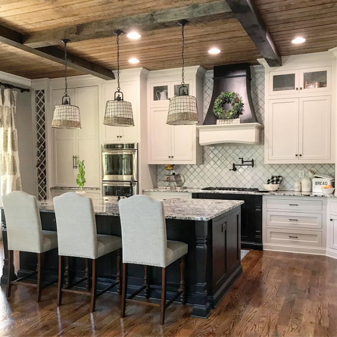 Farmhouse kitchen with white cabinets, black island and beamed V-Groove Pine Plank ceiling. Farmhouse kitchen with white cabinets, black island and beamed V-Groove Pine Plank ceiling. Farmhouse kitchen with white cabinets, black island and beamed V-Groove Pine Plank ceiling #Farmhousekitchen #whitecabinets #blackisland #beamedceiling # VGroovePinePlank #plankceiling Home Bunch Beautiful Homes of Instagram @mygeorgiahouse