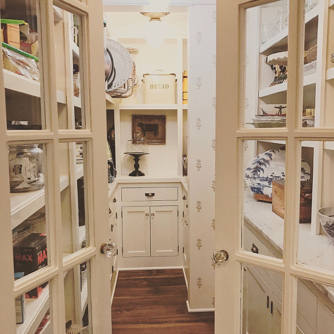 Kitchen Pantry door. Kitchen pantry with glass doors and glass knobs. Doors are salvaged from another old home - just painted in a white paint color - Benjamin Moore White Dove. #kitchenpantrydoor #pantrydoor Beautiful Homes of Instagram @SweetShadyLane